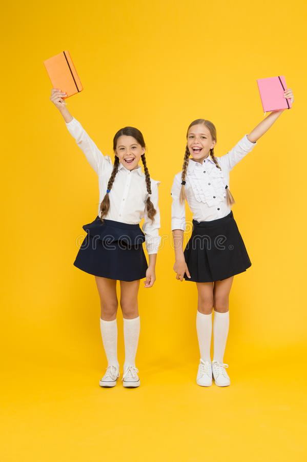 Homeschooling concept. small girls kids with book. reading and writing. happy girls study with workbook. literature. Lesson. childrens literature. back to stock photos