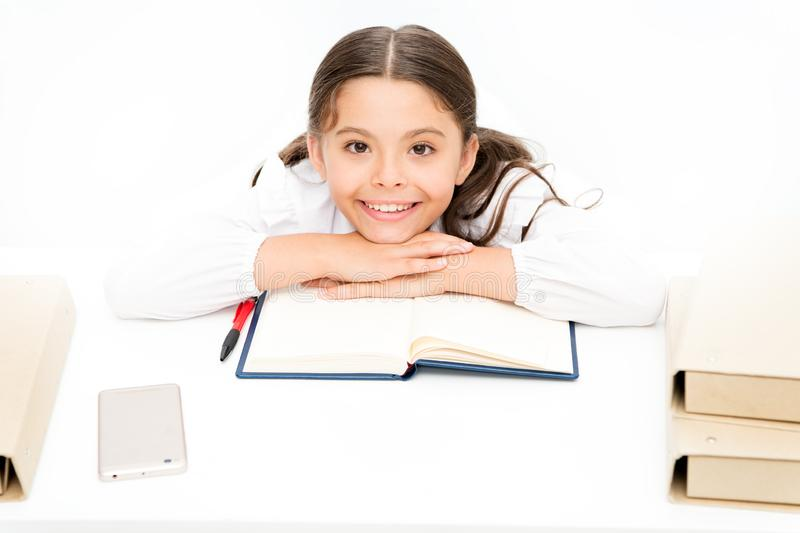 Homeschooling. dictionary notebook. Get information. cheerful girl with workbook. Education. reading story. childrens. Literature. small girl in school uniform stock images