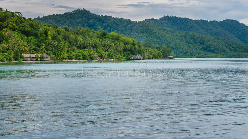 Homestay on Kri Island, Monsuar in Background, Raja Ampat, Indonesia, West Papua. Homestay on Kri Island, Monsuar in Background, Raja Ampat, Indonesia, Papua royalty free stock image