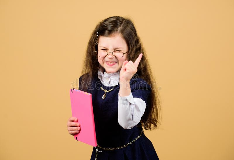 Hometwork. small girl with paper folder. notebook for diary notes. study lesson. serious small girl wants to be teacher. Knowledge and education. Back to stock images