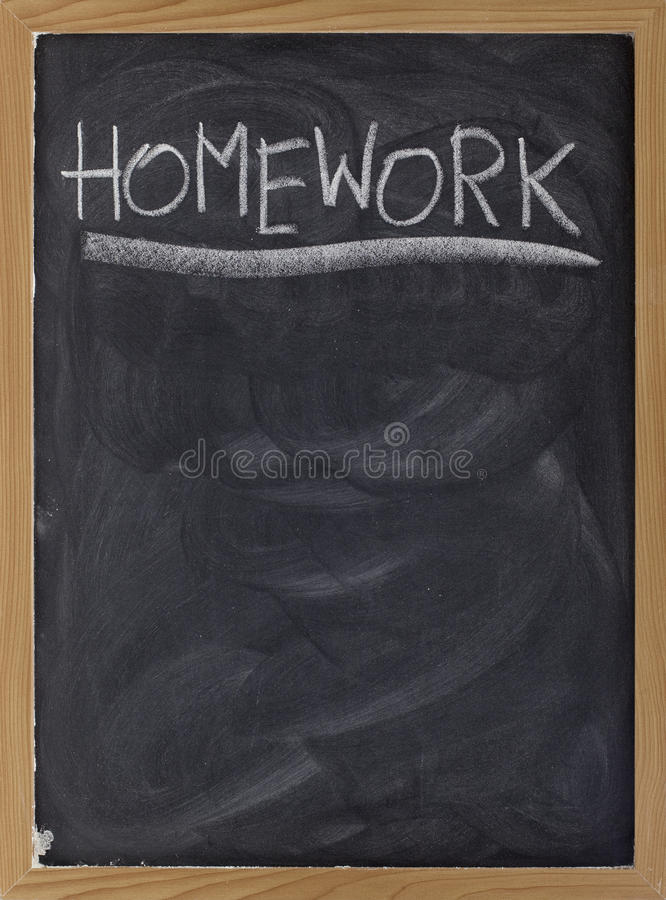 Homework assignment on blackboard royalty free stock photography