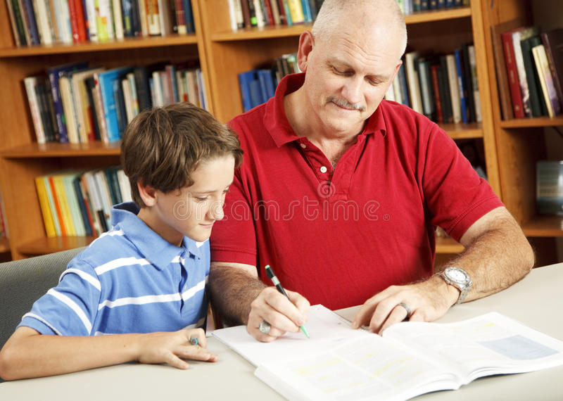 Download Homework Help From Dad stock photo. Image of homework - 16612194