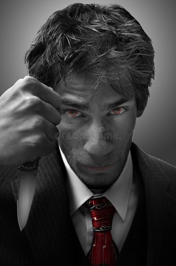 Homicidal Murderer Threatening with knife stock photos