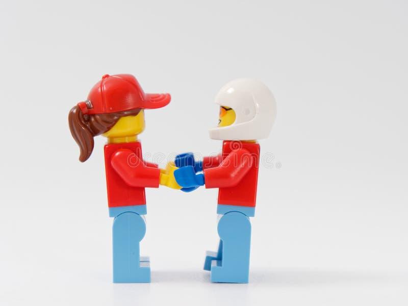 HOMIEL', BIELORUSSIA - 4 GENNAIO 2019: Progettista di LEGO bagnini di eroi su un fondo bianco immagine stock