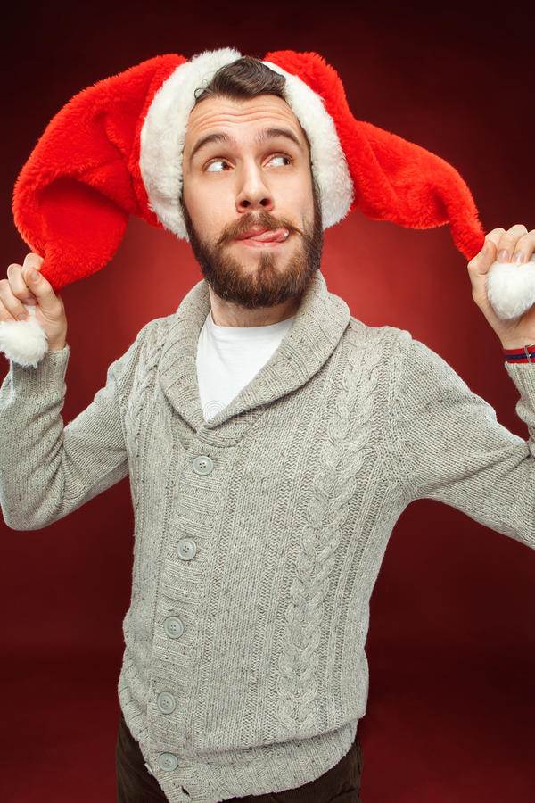Homme étonné de Noël utilisant un chapeau de Santa photo libre de droits