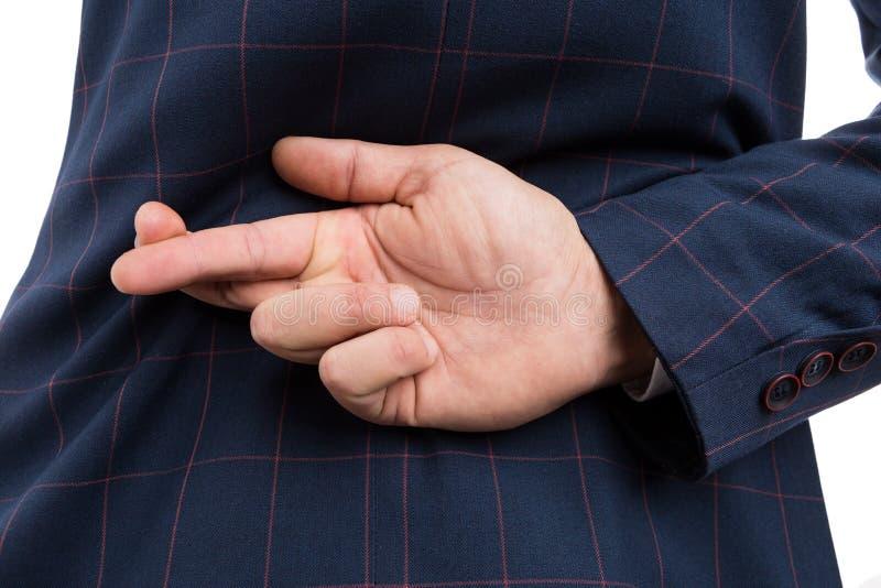 Homme adapté avec des doigts croisés derrière de retour photos stock