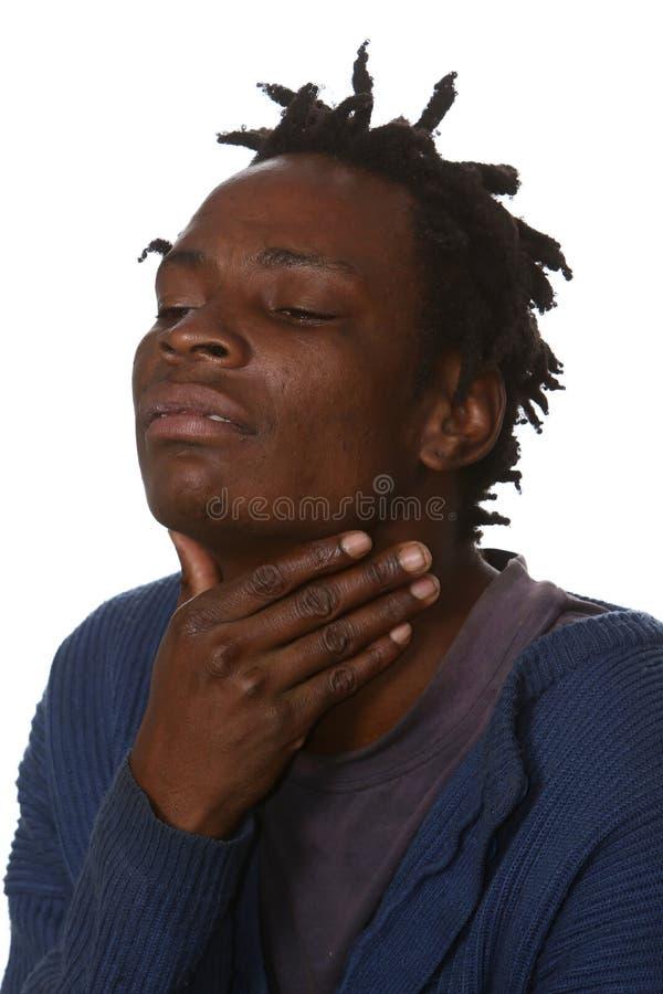 Homme africain avec la gorge endolorie photos stock