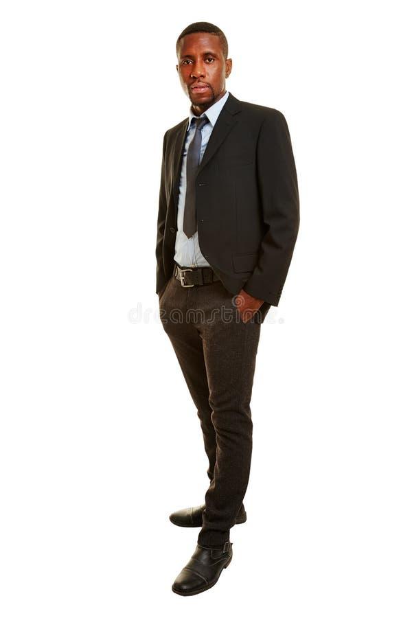 homme africain comme homme d 39 affaires dans un costume image stock image du africains confiant. Black Bedroom Furniture Sets. Home Design Ideas