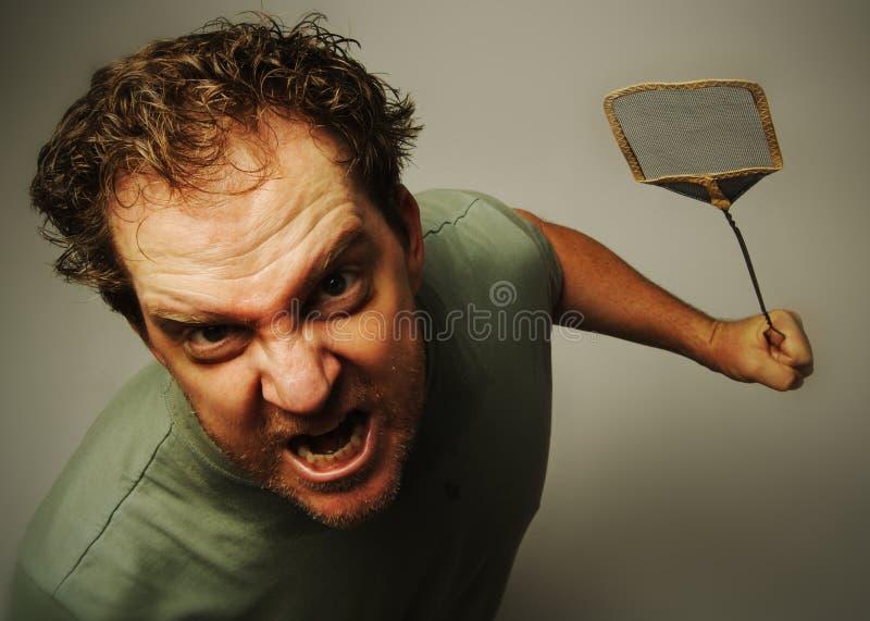 Homme après des mouches photographie stock libre de droits