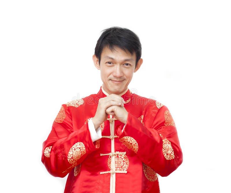 Homme asiatique avec le cheongsam de robe ou le costume traditionnel chinois de saveur photos stock