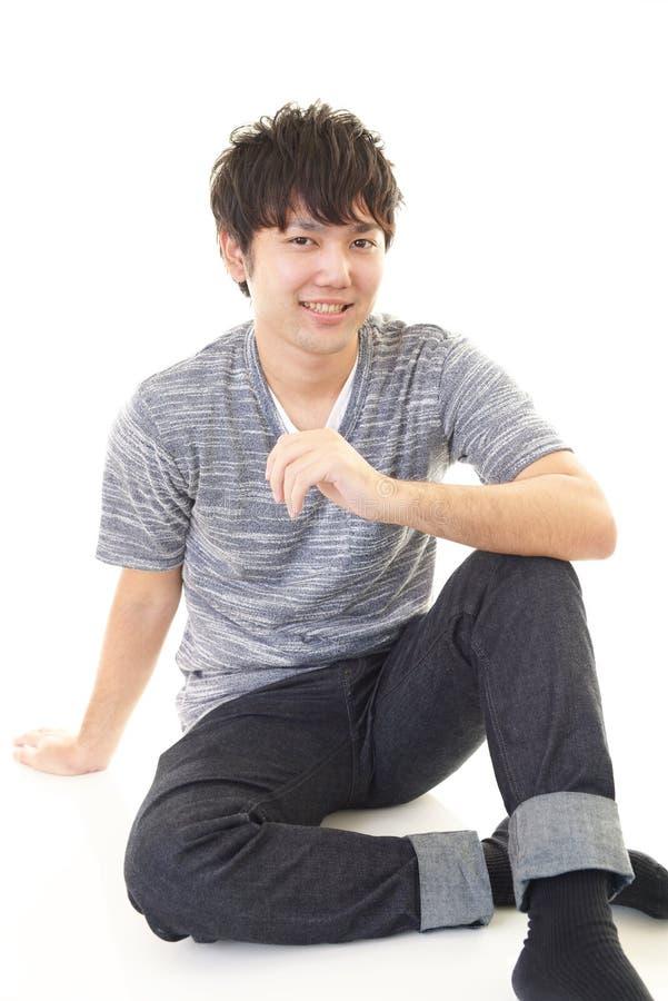 Homme asiatique décontracté photographie stock