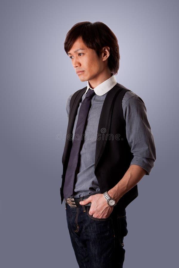 Homme asiatique déprimé d'affaires photo stock