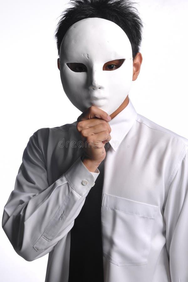 Homme asiatique d'affaires se cachant derrière le masque images stock