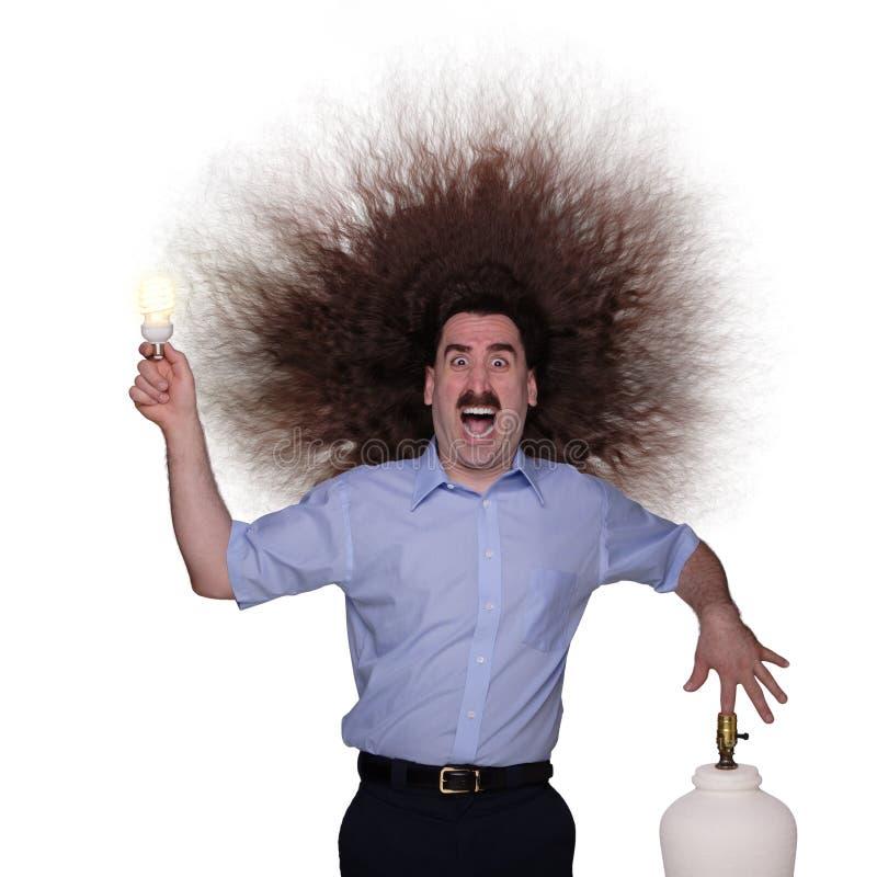 Homme aux cheveux longs étant électrocuté 1 photographie stock libre de droits