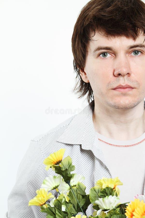 Homme avec des fleurs. photos libres de droits