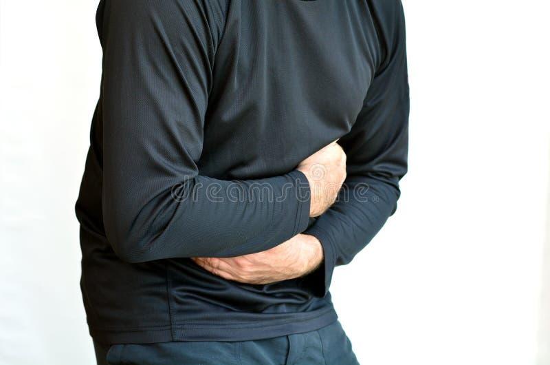 Homme avec douleur d'estomac image stock