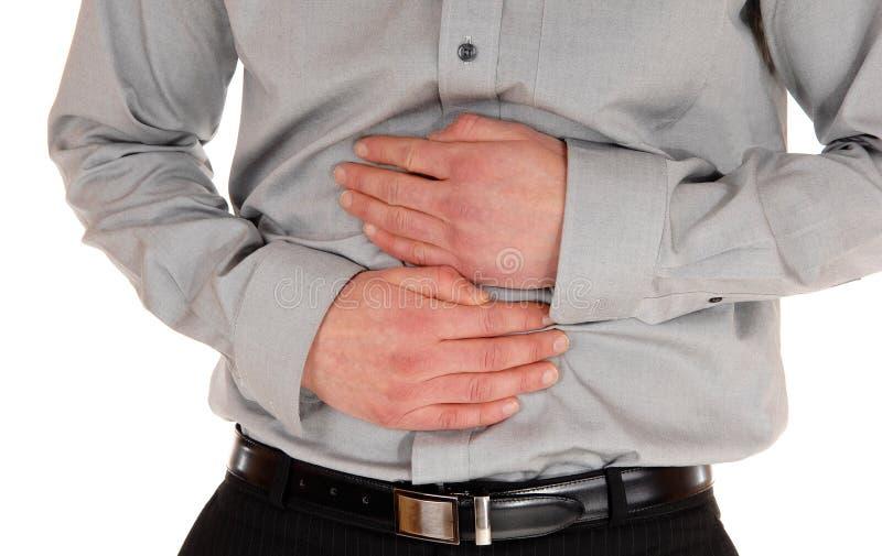Homme avec douleur d'estomac photographie stock