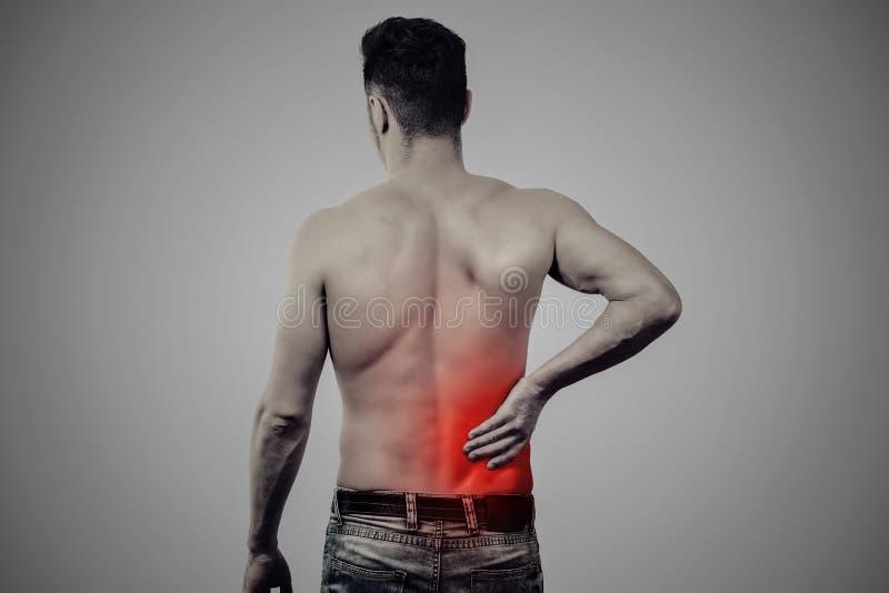 Homme avec douleur plus lombo-sacrée image stock