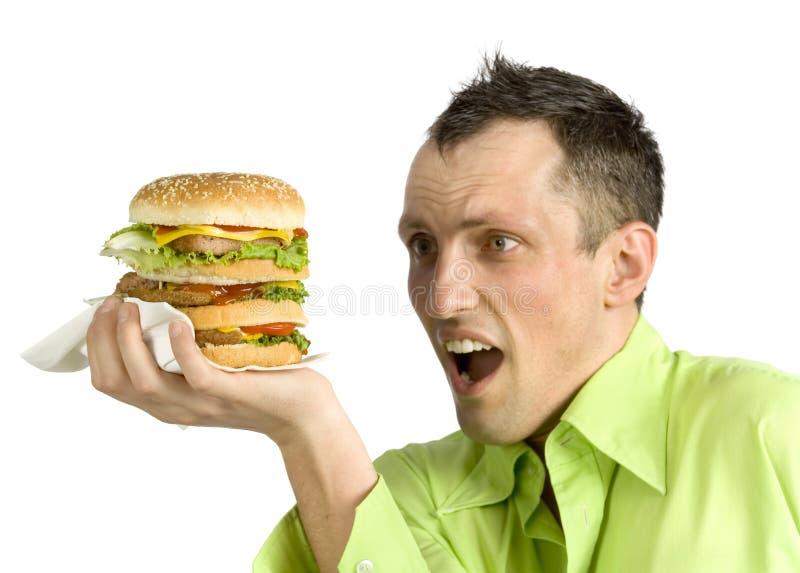 Homme avec l'hamburger photos libres de droits