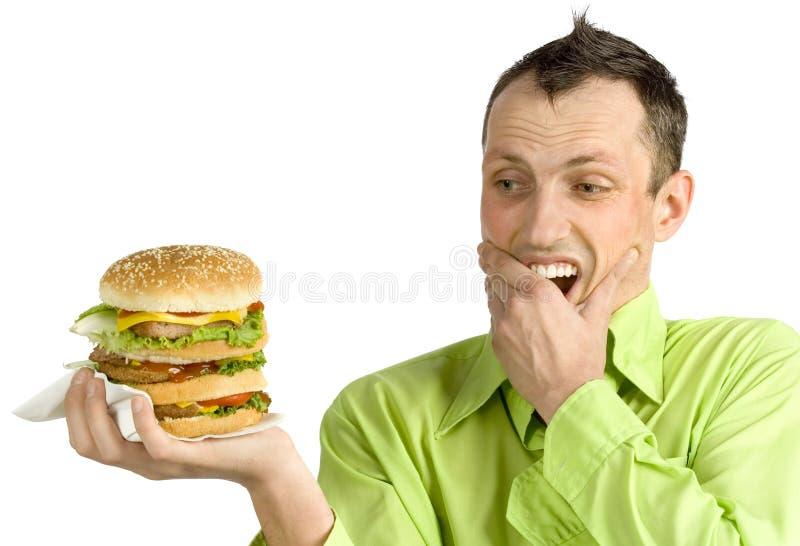 Homme avec l'hamburger photographie stock libre de droits