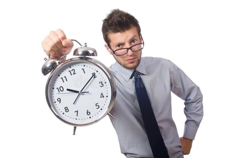 Homme avec l'horloge essayant de respecter la date-butoir d'isolement photo stock