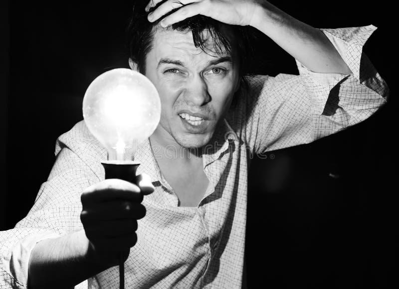 Homme avec la lampe. images libres de droits