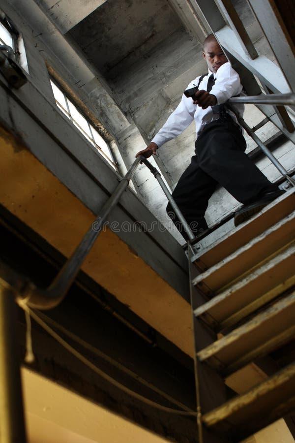 Homme avec le canon photo stock