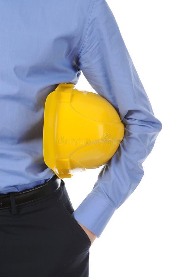 Homme avec le casque de construction images stock