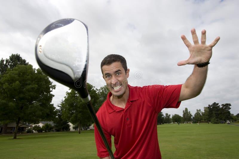 Homme avec le club de golf - horizontal images libres de droits