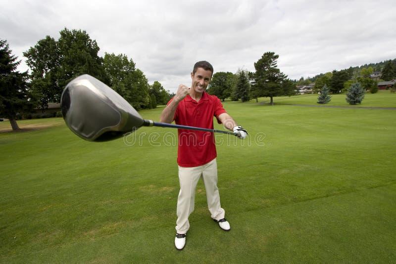 Homme avec le club de golf - horizontal photo stock
