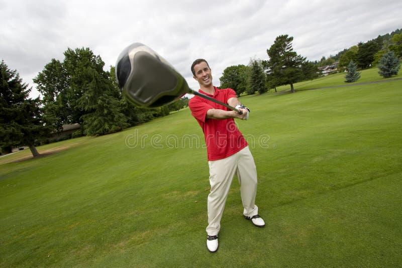 Homme avec le club de golf - horizontal photographie stock