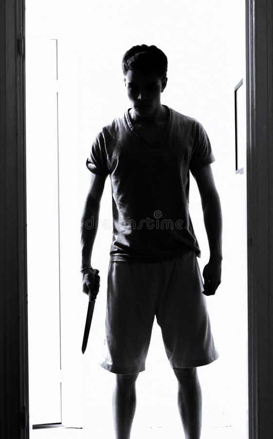 Homme avec le couteau photographie stock libre de droits