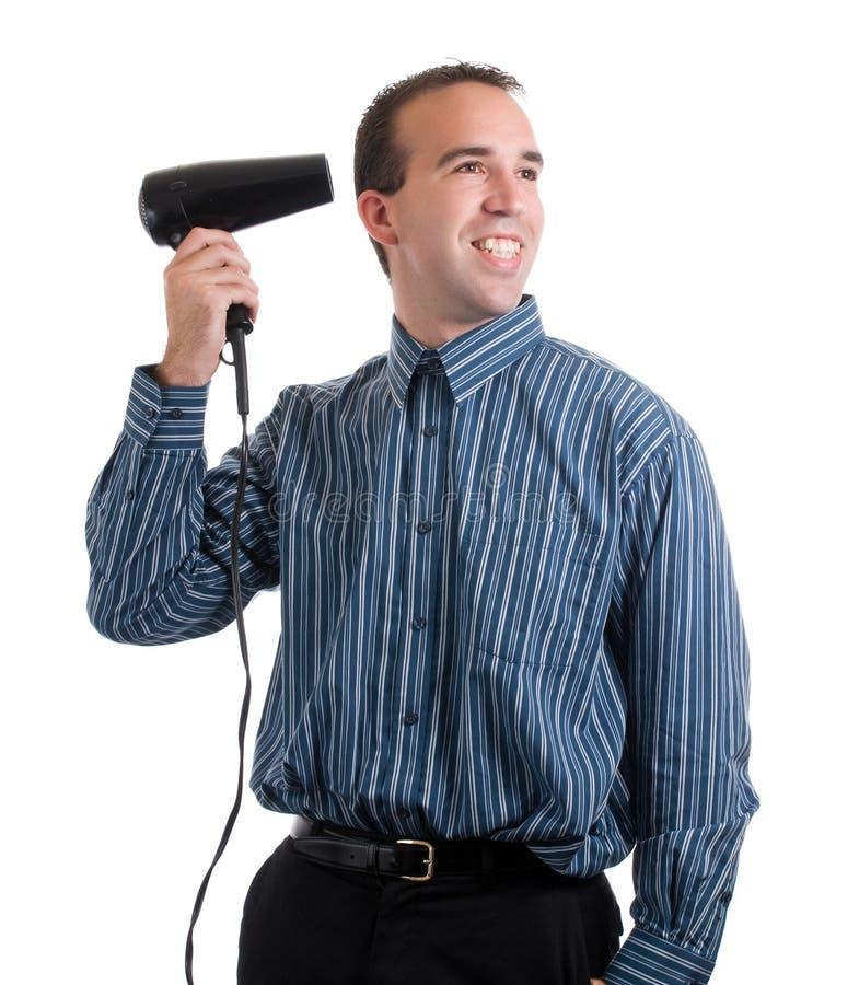 Homme avec le dessiccateur d'air chaud photo stock