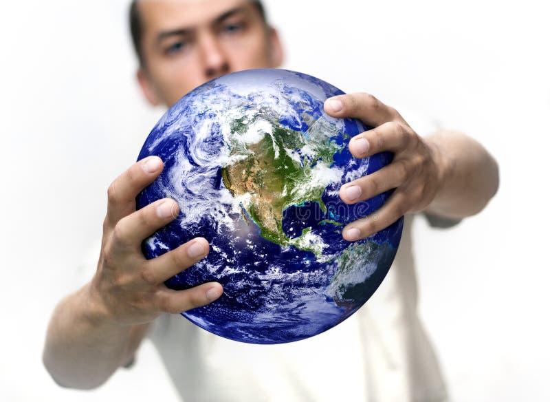 Homme avec le globe photos stock