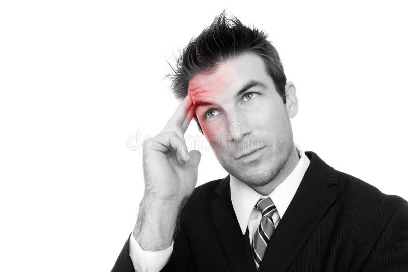 Homme avec le mal de tête photo libre de droits