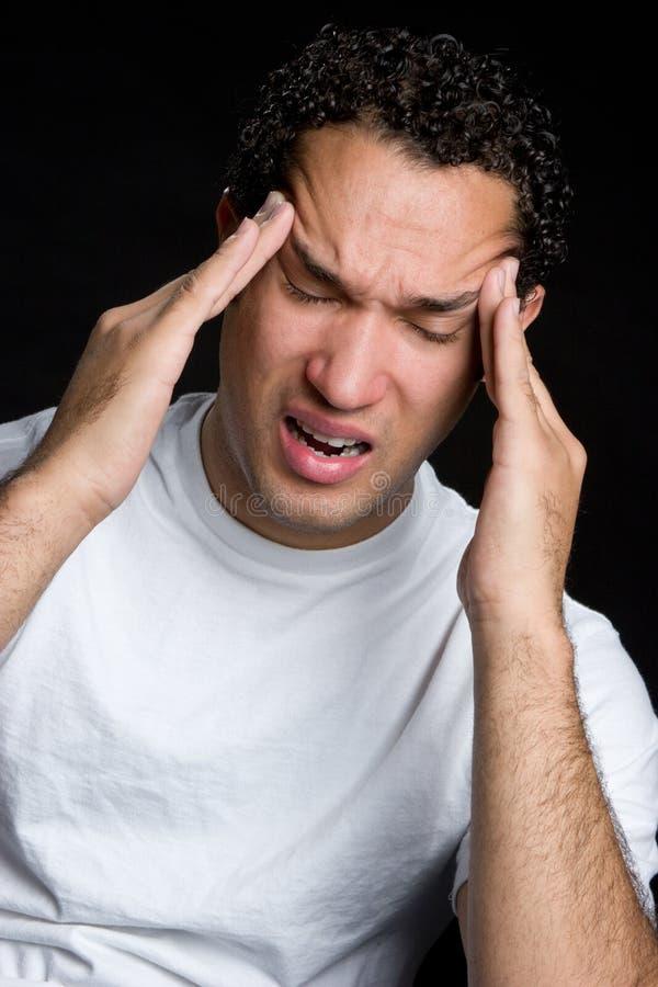 Homme avec le mal de tête photographie stock