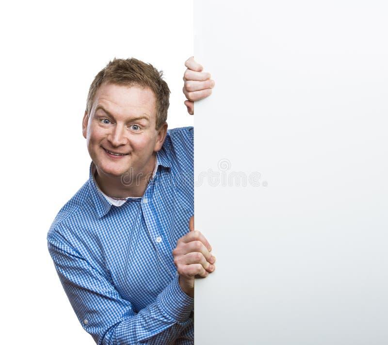 Homme avec le panneau vide de signe photo stock