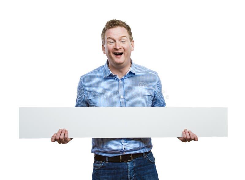 Homme avec le panneau vide de signe photographie stock libre de droits