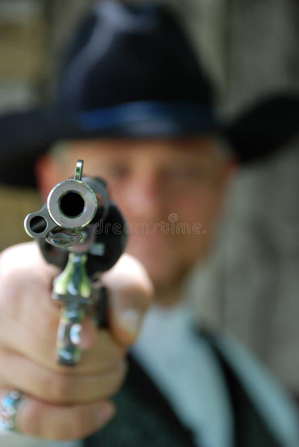 Homme avec le pistolet photos stock