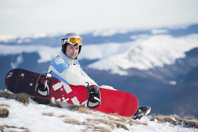Homme avec le snowboard image stock
