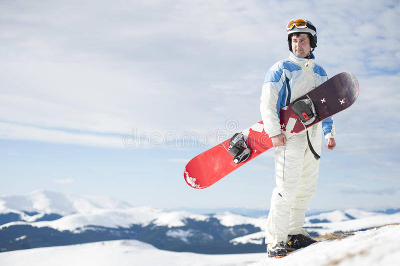 Homme avec le snowboard images stock