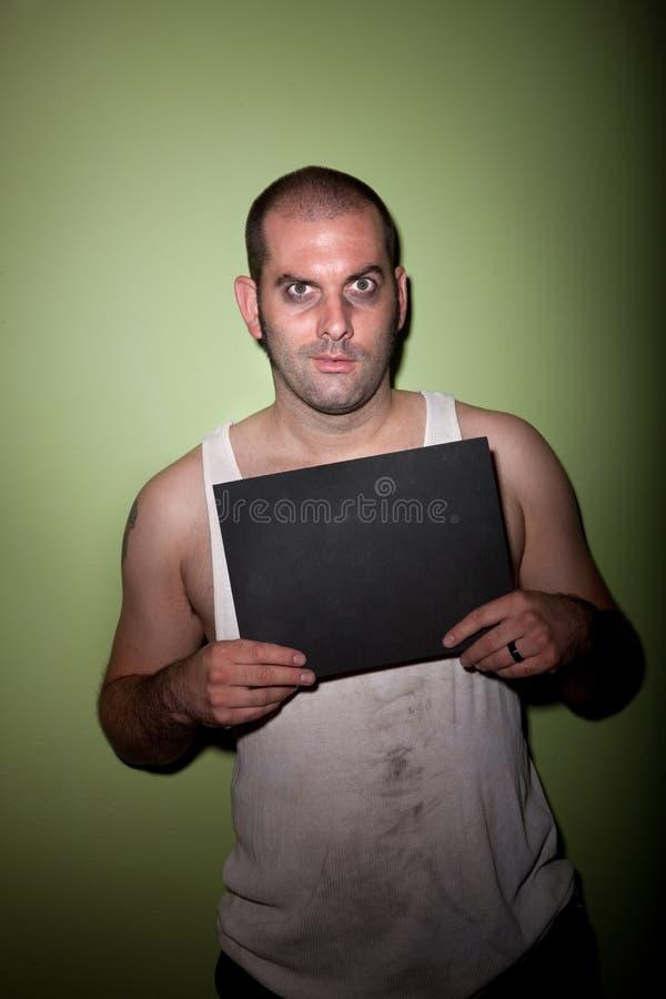 Homme avec le sourire courbé dans la photo image libre de droits