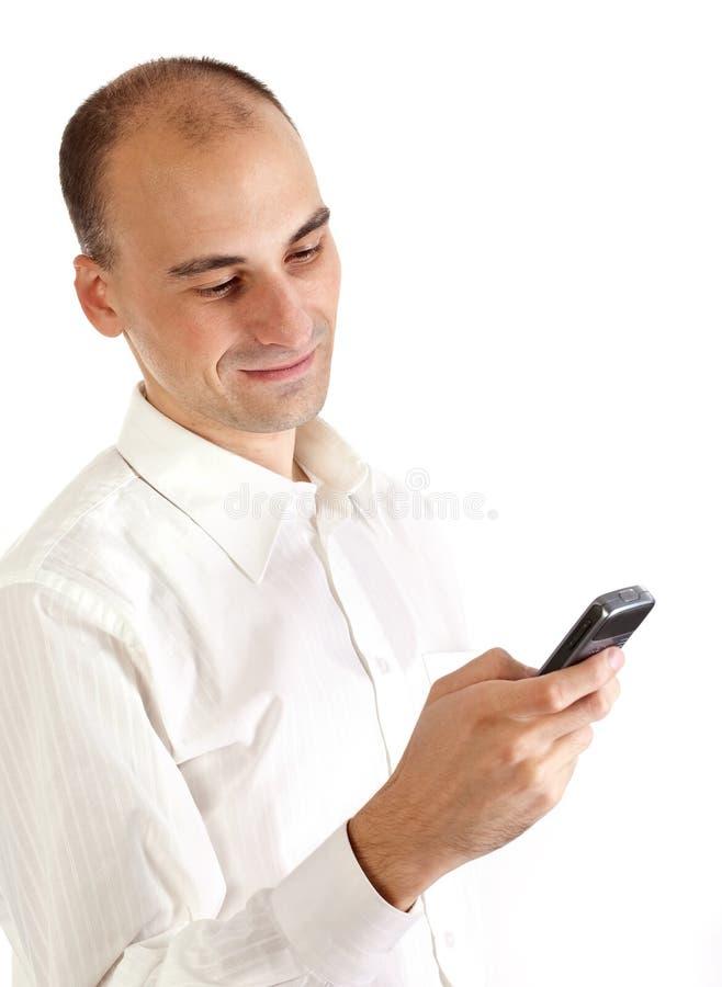 Homme avec le téléphone portable image libre de droits