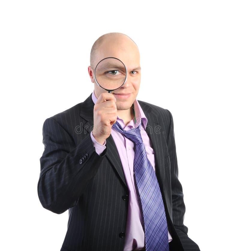Homme avec un agrandissement photos stock
