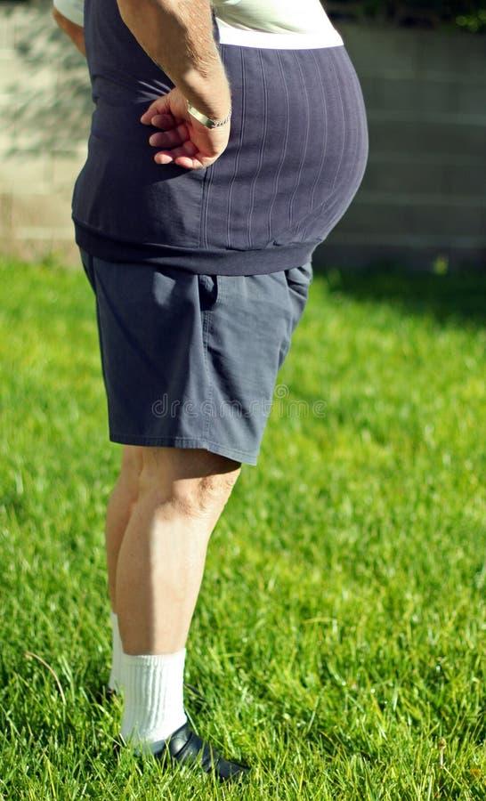 Homme avec un grand ventre photos stock