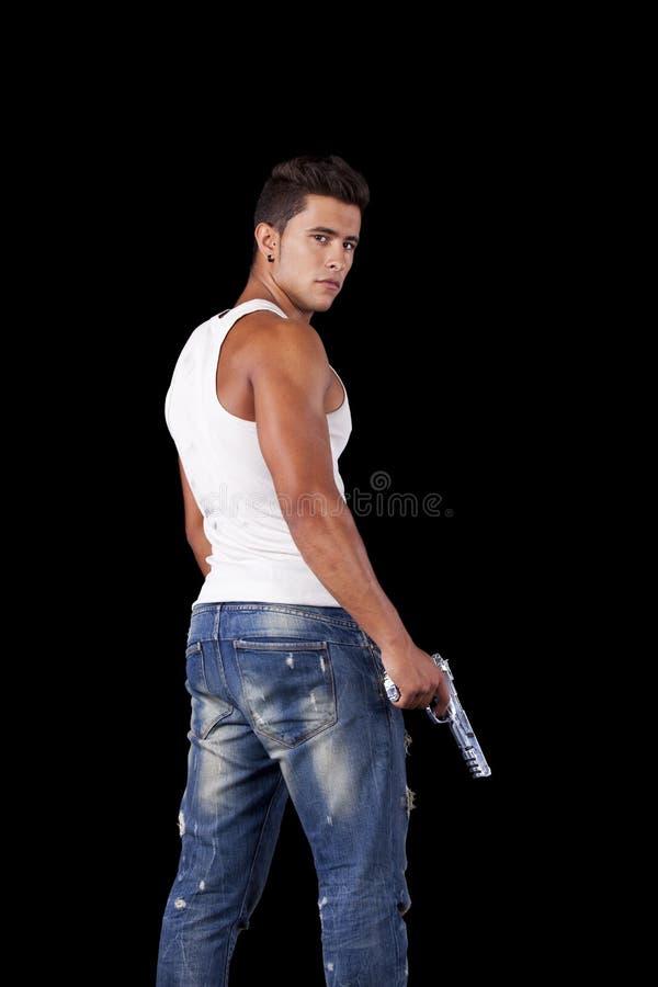 Homme avec un pistolet photo stock
