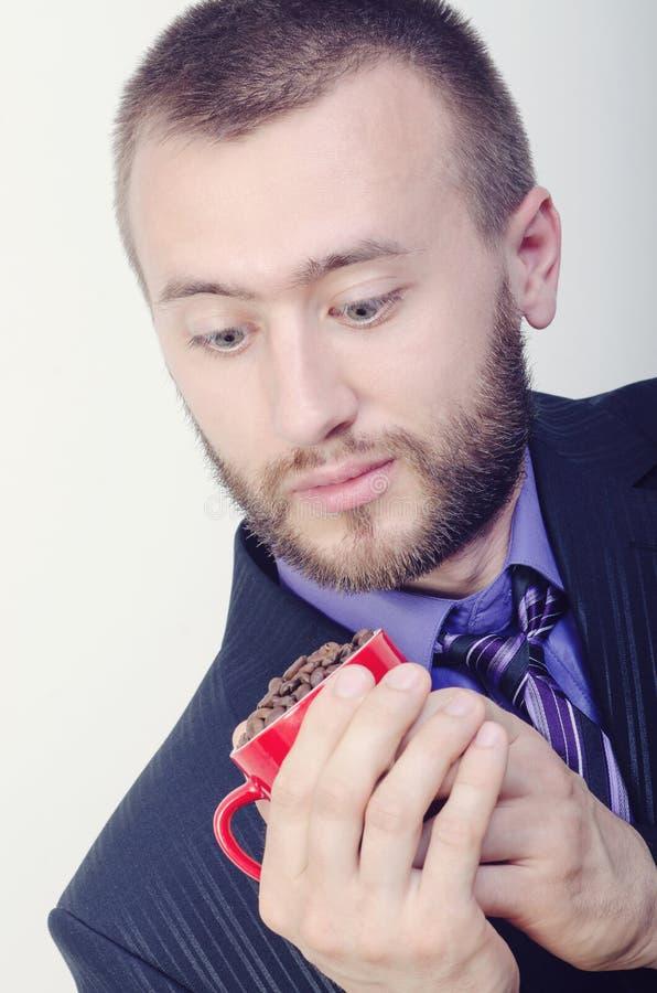 Homme avec une tasse photos stock