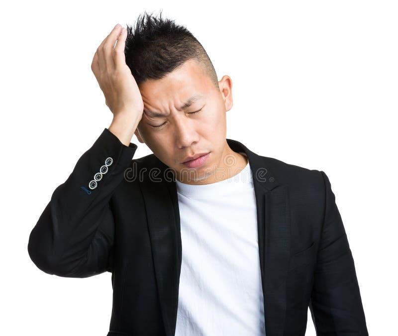 Homme ayant le mal de tête photo stock