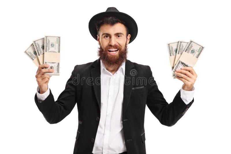 Homme barbu enthousiaste avec des paquets d'argent image stock