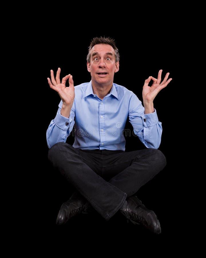 Homme bel d'affaires méditant tirant Fac drôle photos libres de droits
